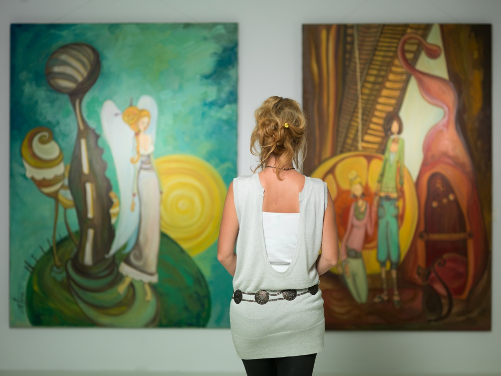 Woman viewing artwork in gallery