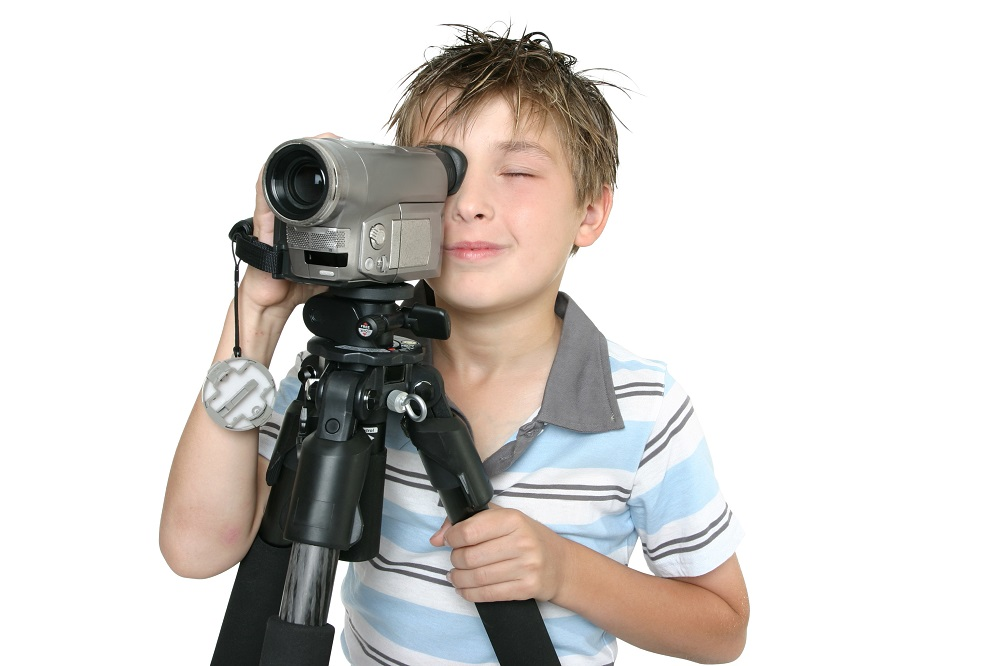 Film Making for Children - boy looking through video camera