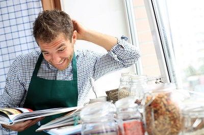 Man scratching his head in confusion over recipe