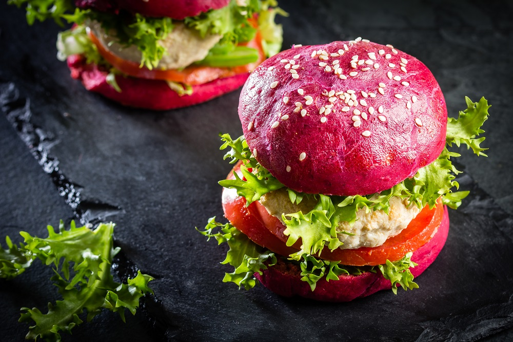 Chicken burger made with beetroot bread rolls
