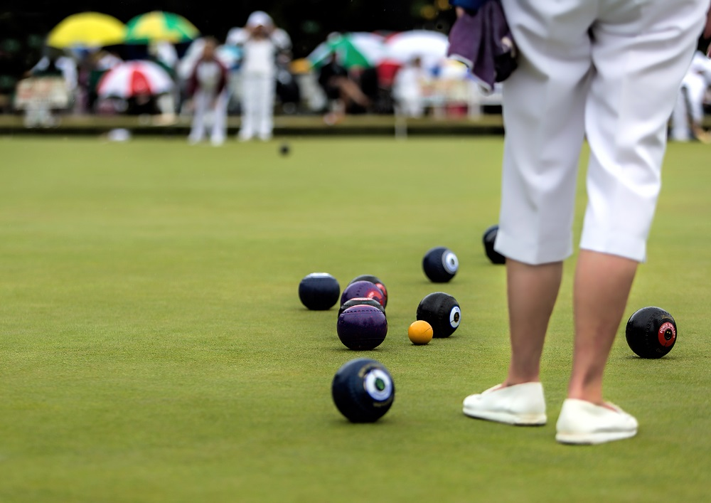 Lawn Bowls 101 Picture of legs and balls on green