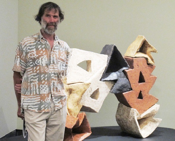 Matt McLean in front of one of his pottery artworks